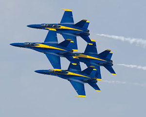 The Blue Angels flying in formation during an air show.